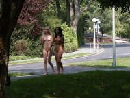 Two naked girls enjoying a leisurely stroll