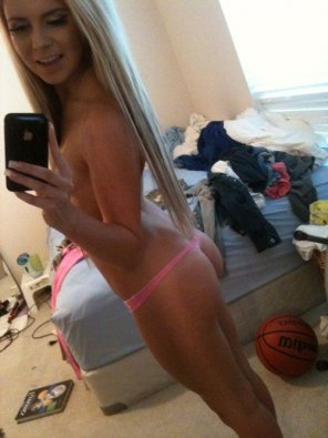 amateur photo Long blonde hair leading to a pink thong