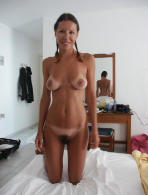 amateur photo Amateur with pigtails, tan lines and bush