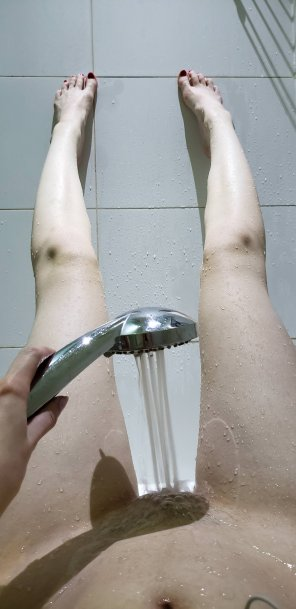 amateur photo Stretching out my long, pale legs in the shower so I can cum a few times :D