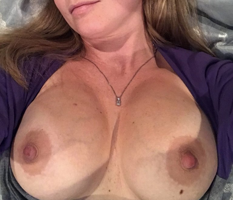 Wife shows breasts