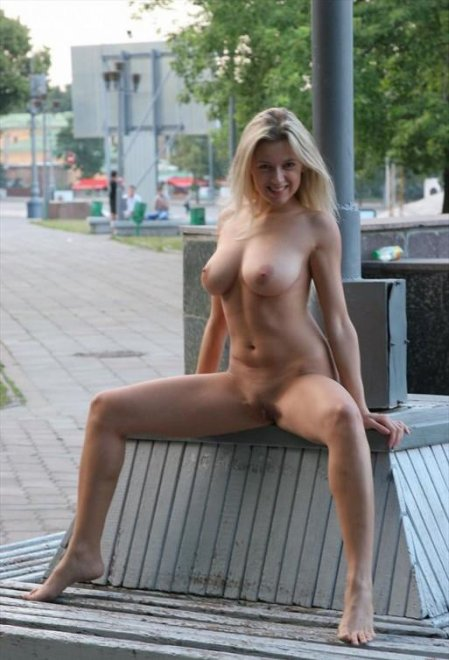 Spreading her legs in public Porn Photo
