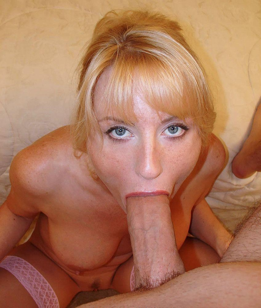 Blonde milf sucking on a huge one Porn Photo