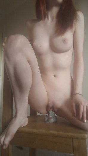 amateur photo Redhead on a dildo