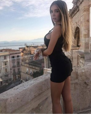 amateur photo Short Black Dress on a balcony