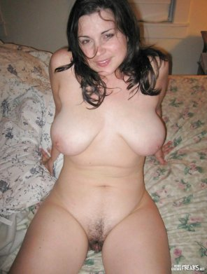 amateur photo Milf propped up on the bed