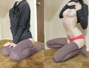 amateur photo Pulling up her sweater