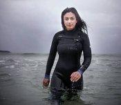 Norwegian politician in tight wetsuit