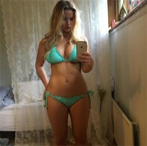 amateur photo Decent looking girl in turquoise bikini