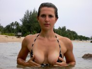 Cute girl in the water and exposing her tits