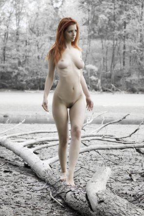 amateur photo Redhead in white forest.