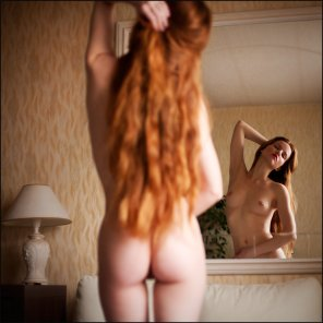 amateur photo Long red hair in the mirror