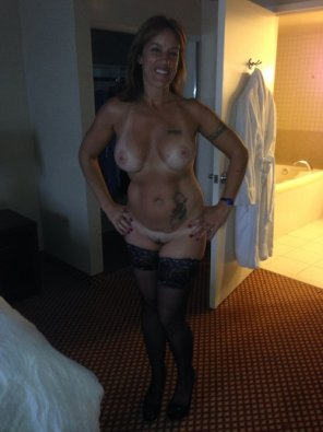 amateur photo Smiling milf in the hotel room