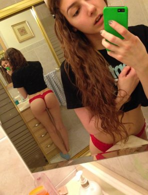 amateur photo Brunette in red thong