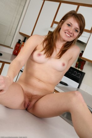amateur photo Redhead on the counter