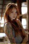 amateur photo Red hair and a sleeve tattoo