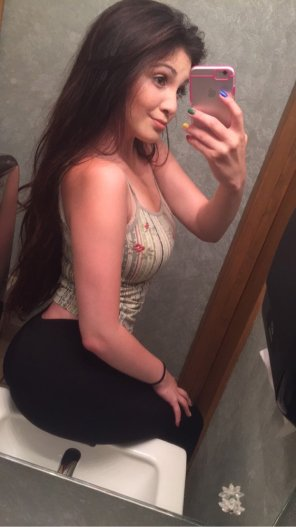 amateur photo Busty Girl Sitting on the Sink
