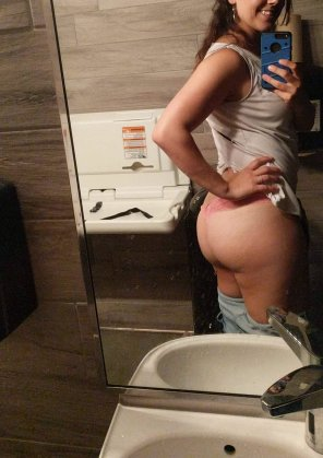 amateur photo Bathroom booty in a thong with a smile.
