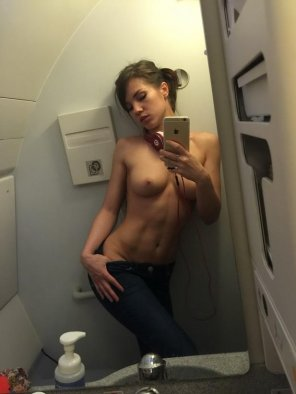 amateur photo Stunning body in the airplane bathroom