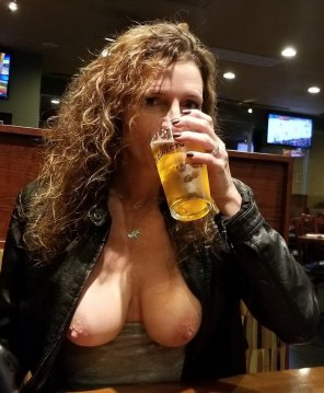 amateur photo Drinking A Beer At A Local Bar