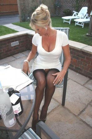 amateur photo Milf in a white dress