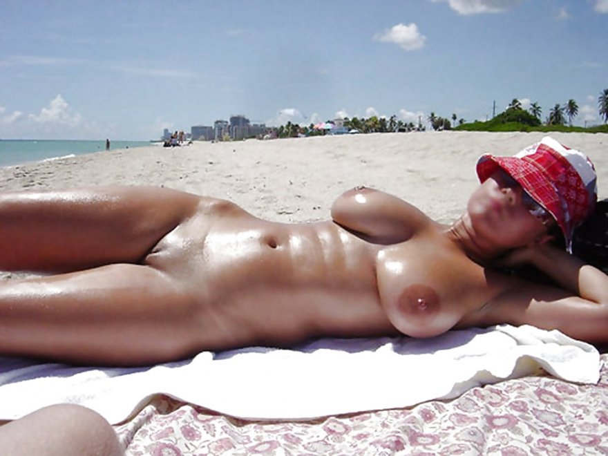 Tanning at the beach Porn Photo