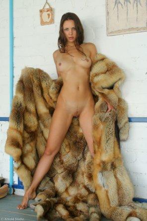 amateur photo Opening her fur coat