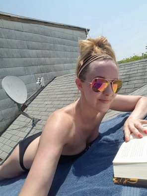 amateur photo Sexy blonde catching some rays on the roof..