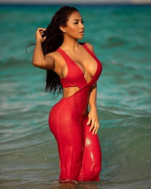 amateur photo Dolly Castro wearing red and wet