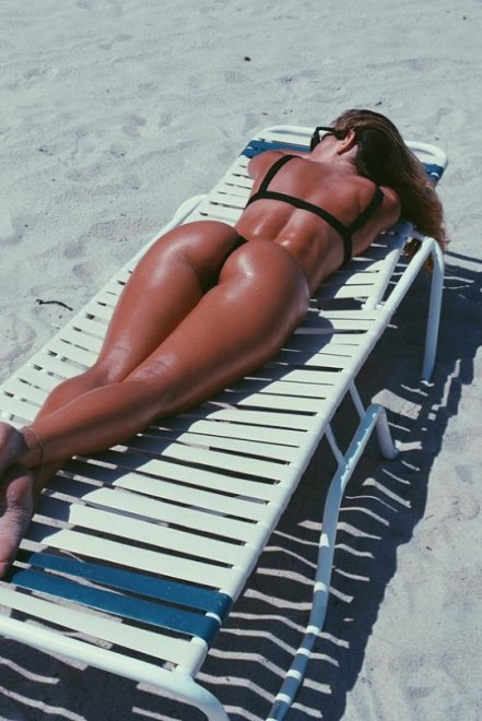 Catching a tan Porn Photo