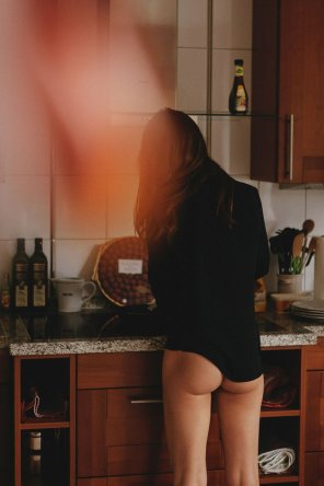 amateur photo Secret picture of her wearing your shirt, making you breakfast...