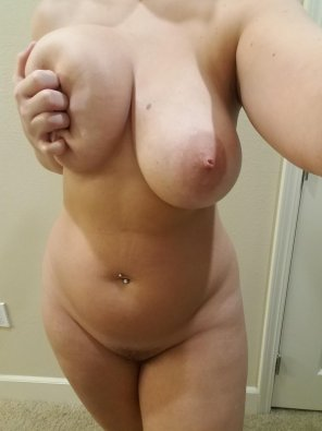amateur photo Squeezing her boob
