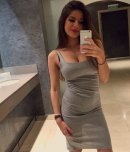 amateur photo sexy chick in a tight grey dress