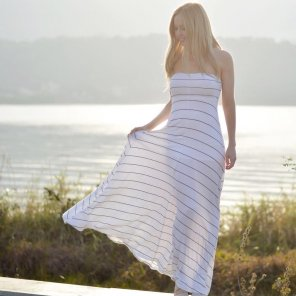 amateur photo Very gorgeous blonde, teasing see thru maxidress