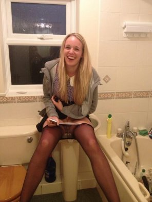 amateur photo Embarrassed girl caught being naughty in the bathroom