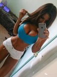 amateur photo Stretching Her Sports Bra