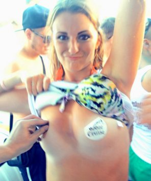 amateur photo Drunk College Girl Flashes Her Pasties on a Boat Party