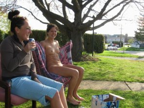 amateur photo Happy embarrassed girls drinking in their front yard