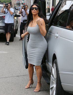 amateur photo Kim Kardashian in a tight grey dress with pokies