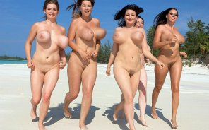amateur photo Four pairs of bouncy swangers on a beach jog