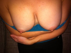 amateur photo My wife pulling down her tank top