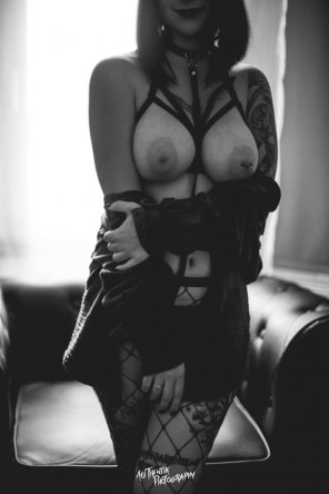 amateur photo Collared goth girl shows off her big pierced tits