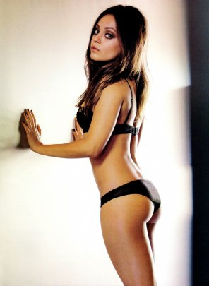 amateur photo Mila Kunis against a wall