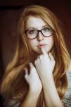 amateur photo Redhead in glasses