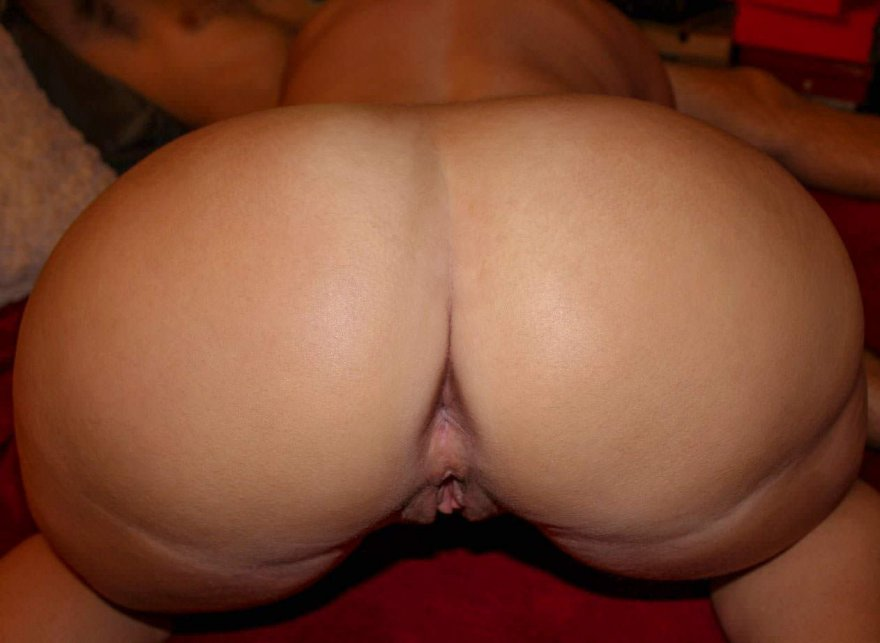 My slutty hotwife showing her rear pussy while she services one of her playmates. Porn Photo