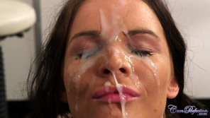 amateur photo Tasha Holz with both her eyes covered in jizz