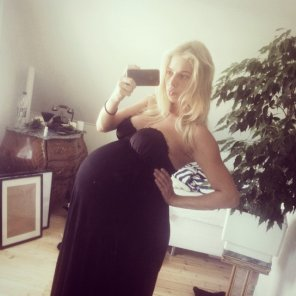 amateur photo Huge blonde in a black dress