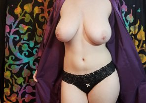 amateur photo Stripping out of a silky purple robe.