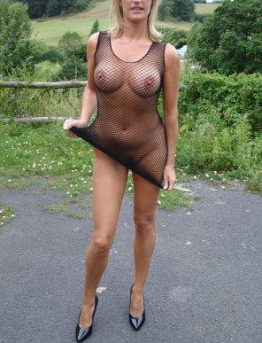 amateur photo Milf in a fishnet dress