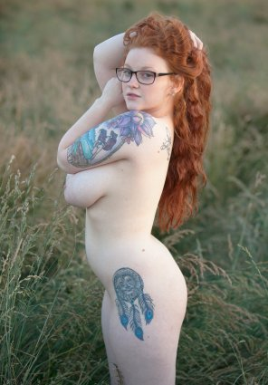 amateur photo Curvy redhead shows her tits and tats